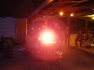 forge running at night in preparation for heat treating some knives
